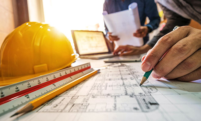 tpe-medium-construction-standards-plans-on-desk-660x396